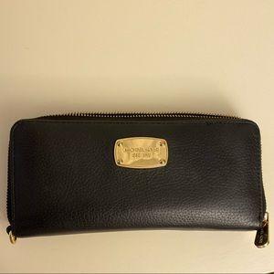 Michael Kors ZIP wallet.